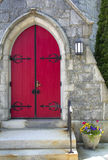 Red doorway, flowers in pot, church, downtown Keene, New Hampshi Royalty Free Stock Image