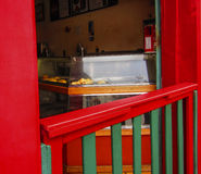Red doorway to shop. Open red door with closed red and green gate into a bakery in Brazil royalty free stock images