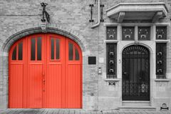 Red doorway on vintage black and white background. Bruges house with brick wall Royalty Free Stock Images