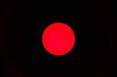Red dot. Close up view of a red lightbulb Royalty Free Stock Photos