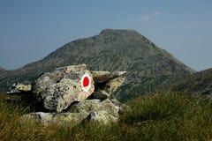 Red dot marking travel. And Retezat Peak in background, in Retezat National Park, Romania Stock Images