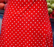 Red dot polka. White dots at red textile polka dress Stock Images