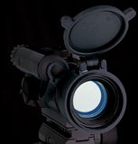 Red dot scope. For assault rifle on black Royalty Free Stock Photos
