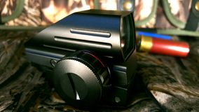 Red dot sight, camouflage,cartridges,tactical black sight, wallpaper royalty free stock photos
