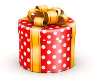 Red doted  gift box. Rounded cylinder red doted gift box with gold ribbons Royalty Free Stock Photos