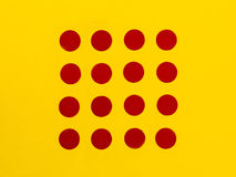 Red Dots on a Bright Yellow Background Royalty Free Stock Photography