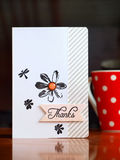 Red dotted cup of coffee with thank you card Royalty Free Stock Photography