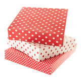Red dotted gifts. Stacked red dotted gifts isolated over white background Stock Photos