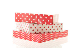Red dotted gifts. Stacked red dotted gifts isolated over white background Royalty Free Stock Photography