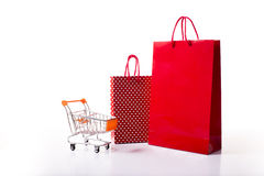 Red and dotted shopping bag. Red colored and white dotted shopping bags isolated on a white background Royalty Free Stock Image