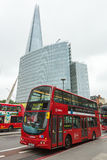Red double decker bus in front of the Shard tower Stock Photos