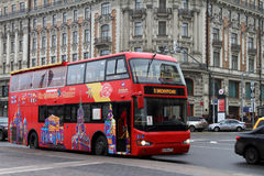 Red double Decker bus on the Mokhovaya street in Moscow. Russia. Royalty Free Stock Images