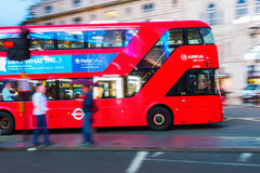 Red double decker bus in motion blur in London night traffic. London, UK - June 19, 2016: red double decker bus in motion blur in London night traffic. The Stock Image