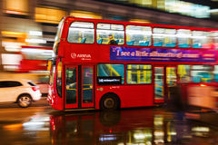 Red double decker bus in motion blur in London night traffic. London, UK - June 19, 2016: red double decker bus in motion blur in London night traffic. The Royalty Free Stock Photo