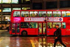 Red double decker bus in motion blur in London night traffic. London, UK - June 19, 2016: red double decker bus in motion blur in London night traffic. The Royalty Free Stock Image