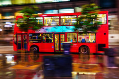 Red double decker bus in motion blur in London night traffic. London, UK - June 19, 2016: red double decker bus in motion blur in London night traffic. The Stock Images