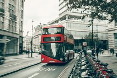 Red double decker bus in motion blur. In London UK Royalty Free Stock Photography
