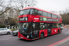 Red double decker bus in motion on the London`s street. LONDON, UK - DECEMBER 19, 2016: Red double decker bus in motion on the London`s street Royalty Free Stock Photo