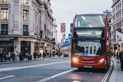 Red double-decker bus on Regent Street, London. The street is decorated with NFL flags to celebrate the event and four NFL games played in capital in 2017 Royalty Free Stock Photo