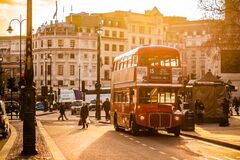 Red Double Decker Bus on Street Near People Royalty Free Stock Images