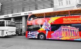 Red double decker bus with tourists for sightseeing tour Monastiraki Athens Greece. MONASTIRAKI ATHENS GREECE, FEBRUARY 18 2017: red double decker bus with Stock Photography