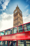Red Double Decker Bus under Big Ben. London travel concept Royalty Free Stock Image