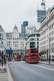 Red double decker buses on King William Street in the City of London, London, UK. stock photo