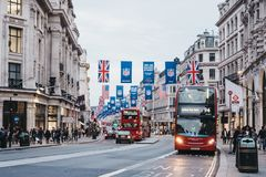 Red double-decker buses on Regent Street, London. The street is decorated with NFL flags to celebrate the event and four NFL games played in capital in 2017 Royalty Free Stock Photos