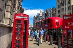 Red double decker buses and telephone booth on London street Royalty Free Stock Photos