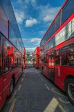 Red double deckers in central bus stop Stratford Stock Photography