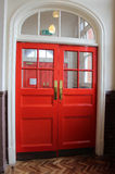 Red double door archway at old victorain schoolhouse entrance Royalty Free Stock Images