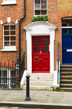 Red double door. Old bricked house with a red double door royalty free stock photos