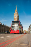 Red doubledecker bus in front of Big Ben, London. Red doubledecker bus in front of Big Ben in London, UK Royalty Free Stock Photo