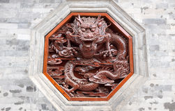 Red dragon carving on wall Stock Photography