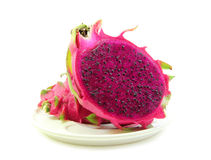Red dragon fruit in dish on white background Stock Photo