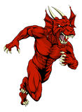Red dragon mascot running Stock Photo