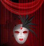 Red drape and carnival mask Royalty Free Stock Photo