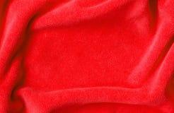 Red draped velvet textile Stock Images