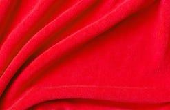 Red draped velvet textile Stock Photo