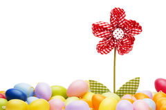 Red drapery flower between easter eggs Stock Photos