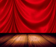 Red Drapes On Stage. Red satin drapery on wood flooring stage Royalty Free Stock Images