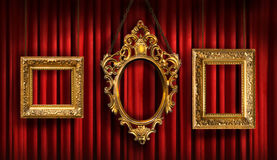 Red drapes with three frames. Red drapes with three gold frames royalty free stock image
