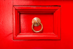 Red drawer. Red vintage drawer, hand-painted, with brass pull Stock Photography