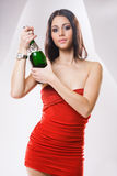 Red dress chaqmpagne brunette. Royalty Free Stock Photo