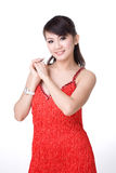 Red dress Chinese girl. Smiling chinese girl in red dress holding both hands Royalty Free Stock Image