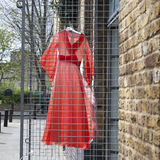 The Red dress hanging on a wire rack for about selling vintage shop Stock Photos