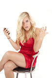 Red dress phone frustration Stock Photography