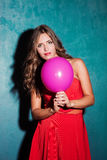 Red dress and pink balloon Stock Image
