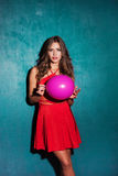 Red dress and pink balloon Stock Images