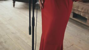 Red dress in retro style of jazz vocalist performing on stage. Dancing. Music. Red dress in retro style of jazz vocalist performing on stage at microphone stock video